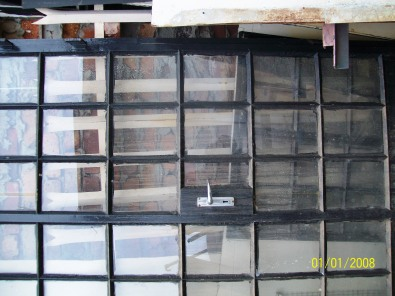 Steel & wooden windows with the glass