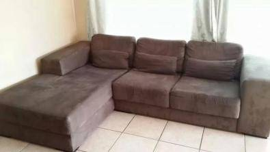 l shaped brown suede couch