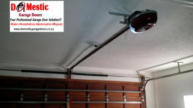 Garage door motor with battery back up automation