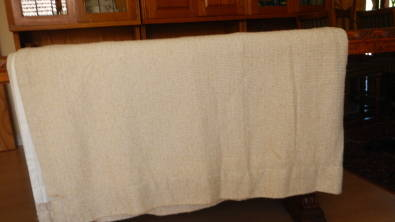 Cream/ oatmeal woven curtains - lined and others.