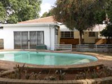 INVEST NOW HAVE TENANT PAY YOUR BOND!!! Large house in Delville Germiston for sale now pool tandem garage