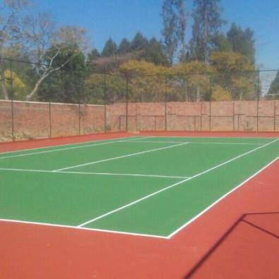TENNIS COURTS AND TAR PAVING