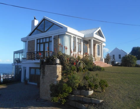 Triple story house overlooking beach in Dana bay.