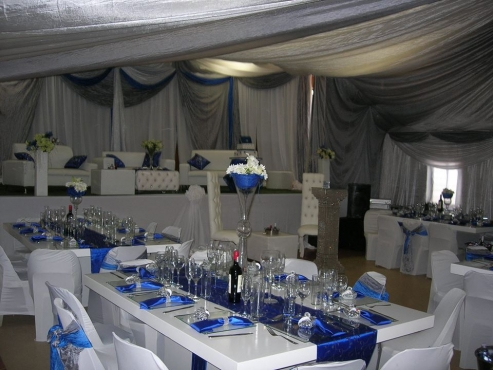 Glass tables and white ten seater tables for sale / rental