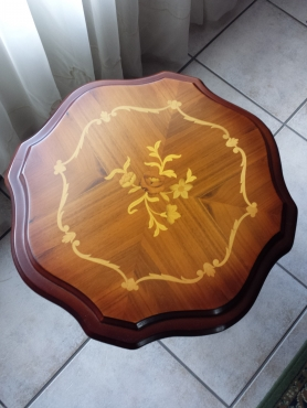 Hand crafted tea table with rose insets.