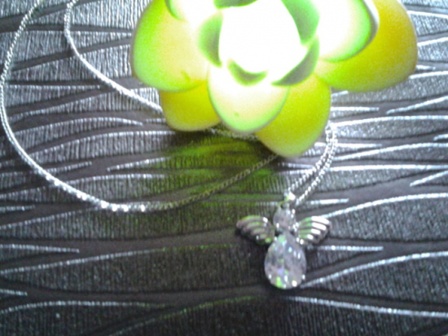 clear quartz crystal angel pendant