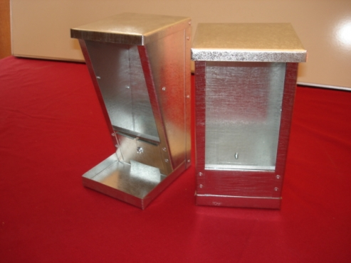 REVERSED Bird Feeders with adjustable LIP to prevent food loss. Phone for pricelist