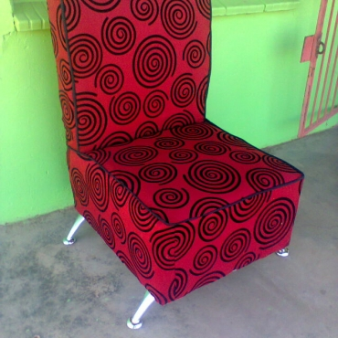 Red corner chair with modern legs