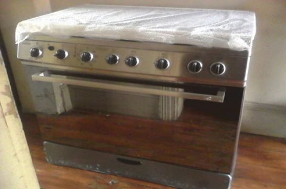 5 plate gas stove ,electric oven with convection and rotisery,brand new