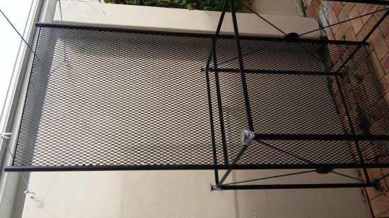 2 x double sided steel, mesh and with glass shelves display stands