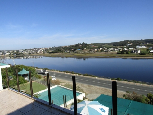 Still Bay. Prime River Front home with 3 bedroom unit on upper level, and spectacular views.