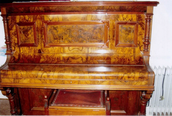 Antique Wallerstein wallnut upright piano.