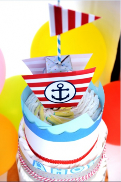 DIAPER CAKES WRAPPED IN A THEME OF YOUR CHOICE