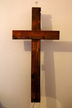Rustic wooden cross wall light made from treated pallet hard wood.