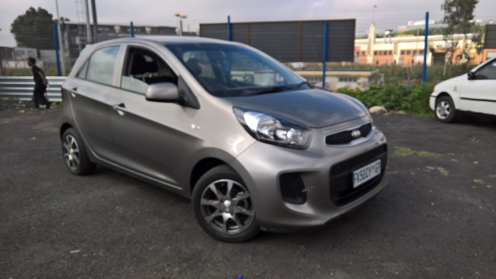 2015 kia picanto 1.0 ls  5-doors,    factory a/c,   c/d player,     central locking,    grey in colo