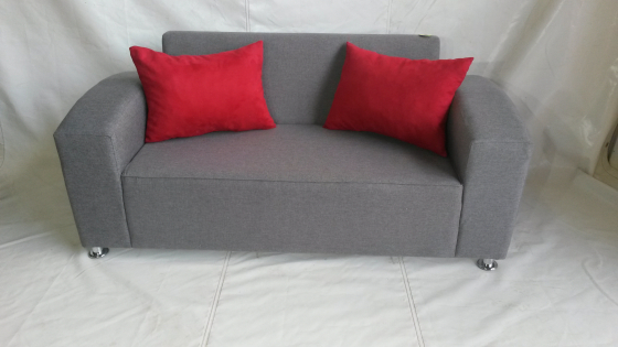Grey couch with red cushions