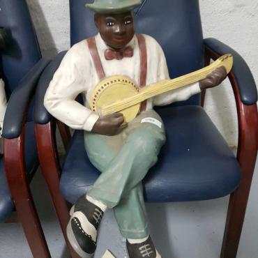 Ceramic Banjo player