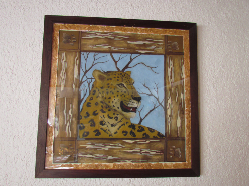Oilpainting with frame:Luiperd