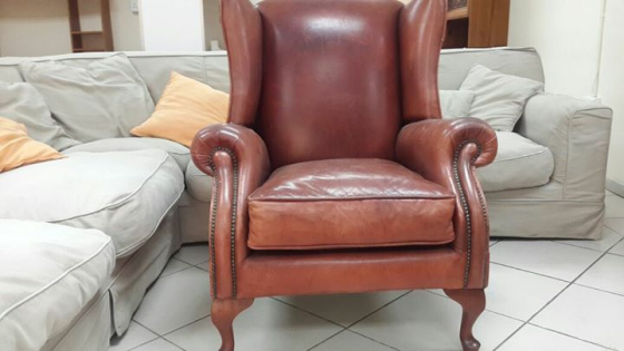 Antique leather cigar chair