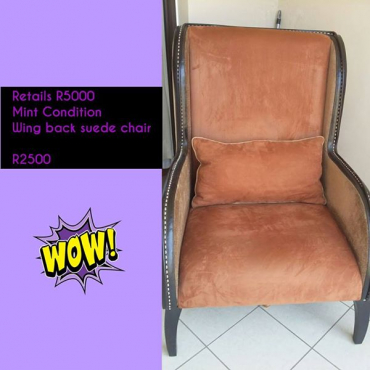 Wingback suede chair