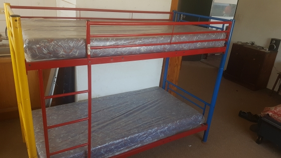 Bunk bed with clean foam mattresses for sale