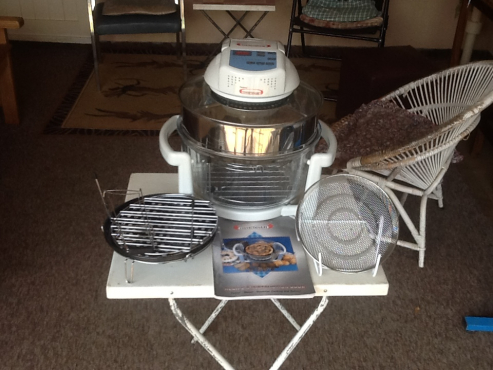 Convectionair electric oven complete with all accessories and book