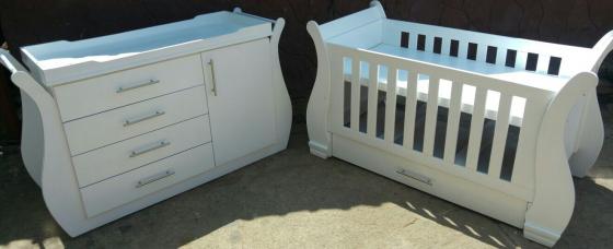 Stylish baby cot and compactum