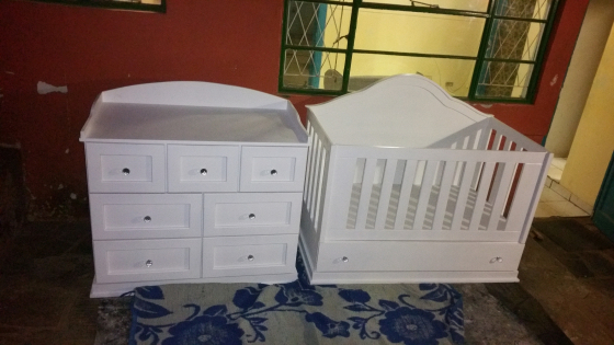 Stylish baby cot and compactum set