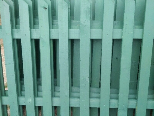 Newly built large green picket fencings