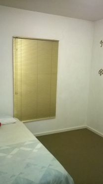Semi-furnished bedroom within upmarket apartment