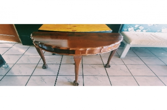 Stinkwood ball & claw half moon table