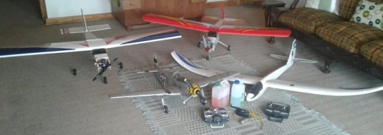 4 x Remote control airplanes for sales with 2 x remotes and petrol