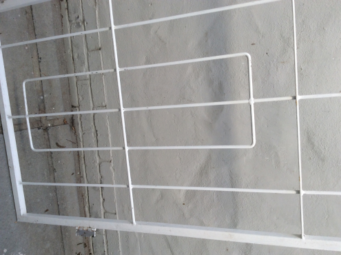 Metal security gate with sliding bolt - white