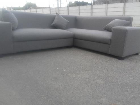 brand new stylish grey corner lounge suite