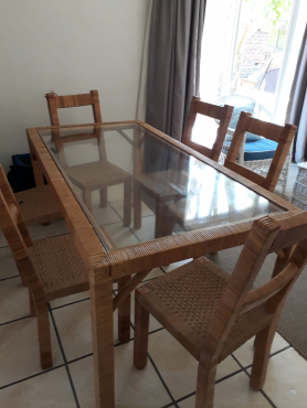 6 seater dining room table with glass top and 6 chairs