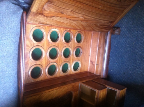 Custom made solid Rhodesian Tleak liquor cabinet with wine rack  R4500 Contact No: 0786758814