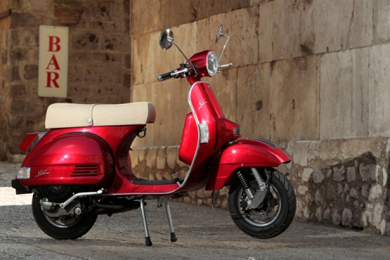 a brand new candy apple red vespa junk mail