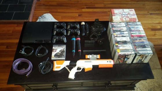 Playstation 3 with 5 remotes, 50 games, Sing Star, gaming gun, Rock Smith with cable and more.