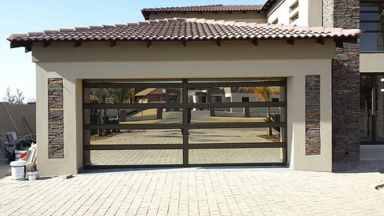 Manufacturing and Installations Aluminum Doors and Garage Doors