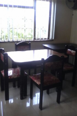 Brand new wooden table and chairs
