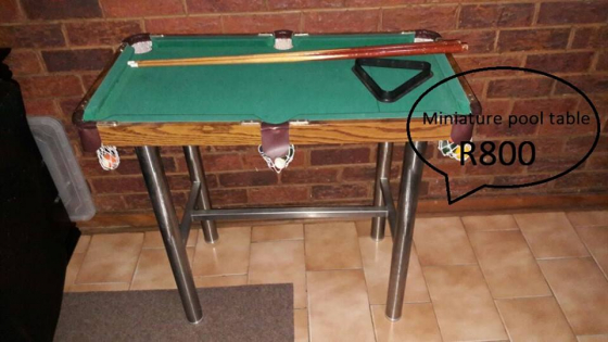 Miniature pool table with balls,