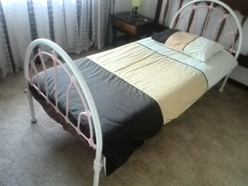 Unique designer bed in two tone white and pink. fabricated from steel and aluminium cladding