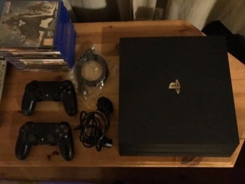 BRAND NEW PLAYSTATION 4 PRO 1TB WITH TWO CONTROLLERS
