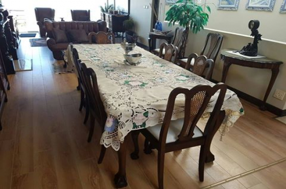 Imbuia dining room suite with glass top table,8 chairs and side board