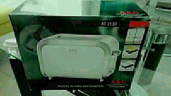 AEG 2 slice toaster with integrated bun warmer.