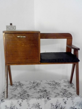 Old telephone table for sale.