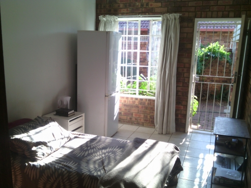 Furnished room to let in security complex