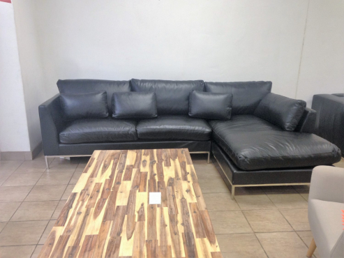 SALE NOW ON. Never been used genuine leather corner couch. Retails for R30 000. This couch is modern