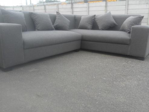 new beautiful grey corner lounge suite