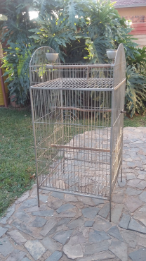 Bird cage with wheels for large breed bird.